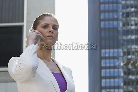 portrait of a businesswoman talking on
