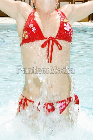 young woman splashing water in a