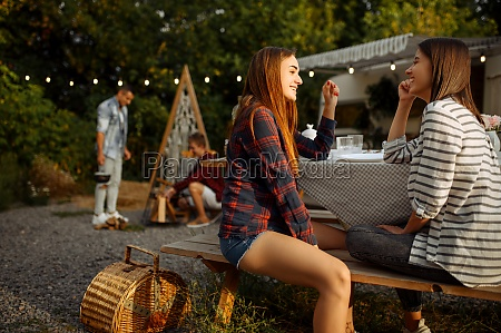 young friends relax on picnic at