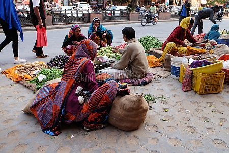 indian women in brightly colored saris