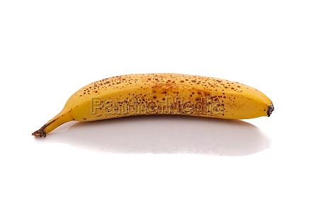 ripe yellow banana with brown spots