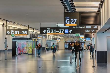 peoples walking in vienna airport terminal