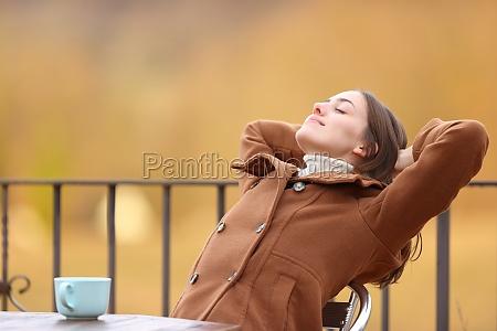 happy woman relaxing in a terrace