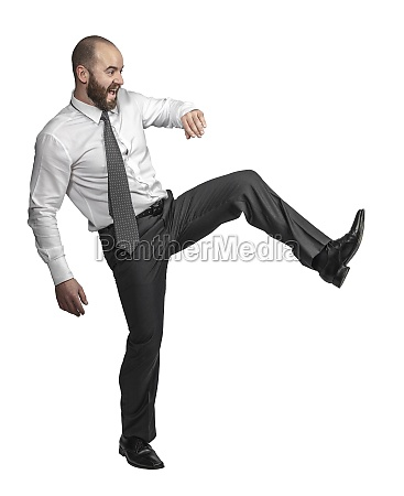 caucasian businessman in kicking position