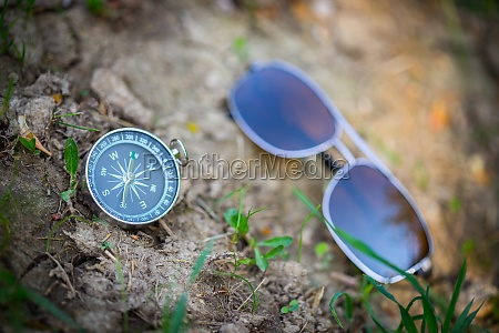 adventure compass and sunglasses are lying