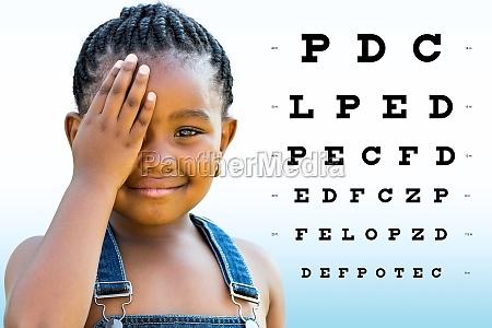 little african girl testing eyesight