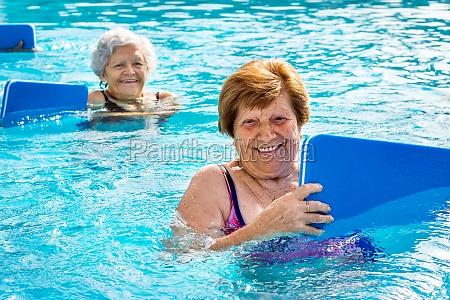 senior women doing aqua exercise with