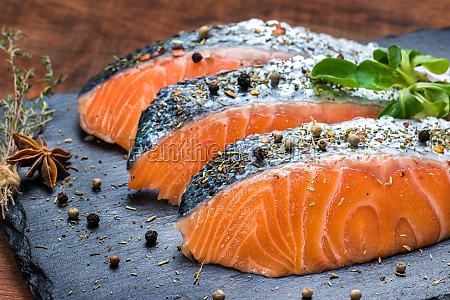 fresh salmon portions with herb and