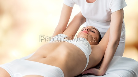 osteopath stretching womans shoulder blades
