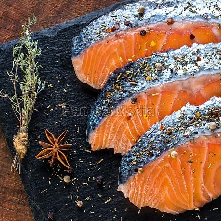 raw salmon portions seasoned with fine