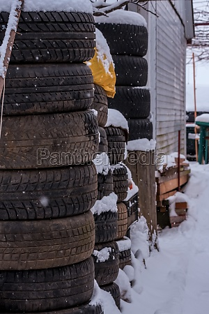 pile of tires during winter in