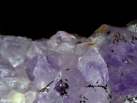 amethyst gemstone cut out on white