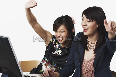 close up of two businesswomen smiling