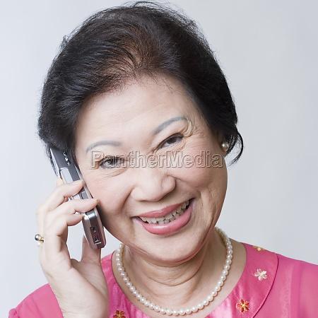 portrait of a senior woman talking