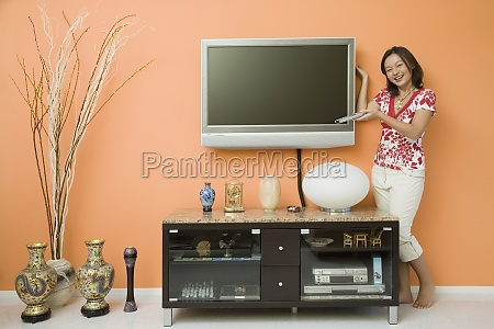 young woman holding a remote control