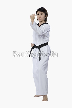 young woman practicing karate