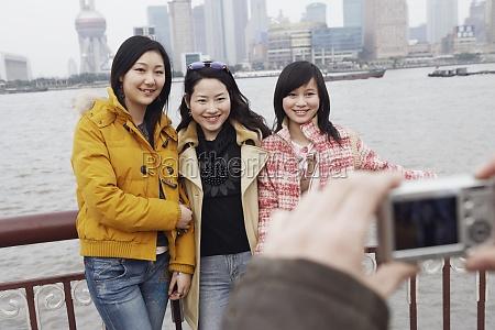 three young women posing