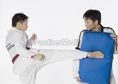 male karate instructor teaching martial arts