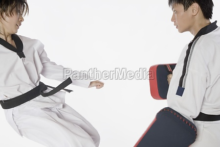 female karate instructor teaching martial arts