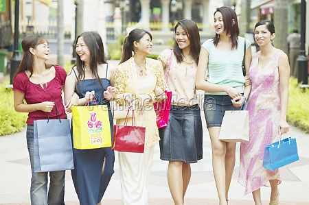 group of women walking with shopping