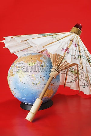 globe covered by parasol