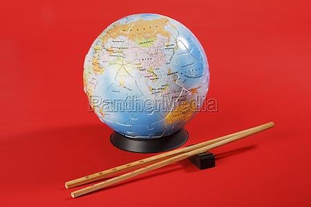 globe with chopsticks