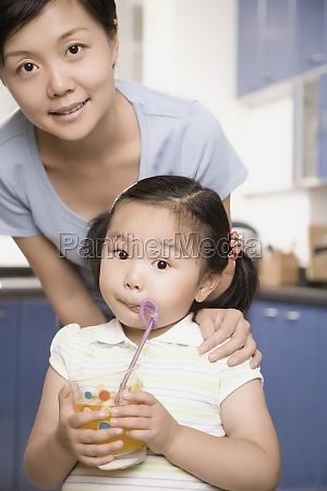 portrait of a girl drinking juice