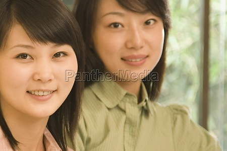 portrait of two female office workers