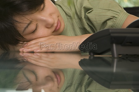 female office worker napping at a