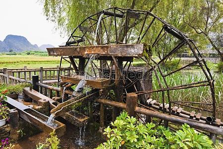 watermill in a field yangshuo guangxi