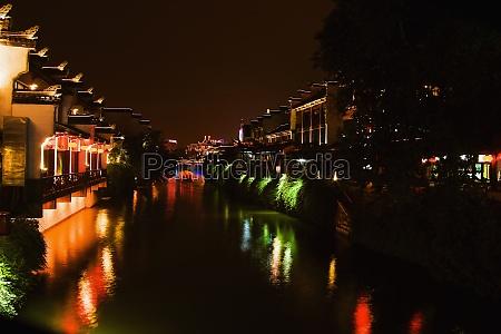 buildings lit up at night nanjing