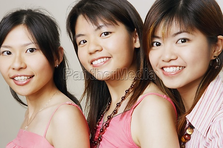 portrait of three young women smiling