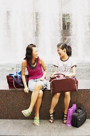 two young women talking near a