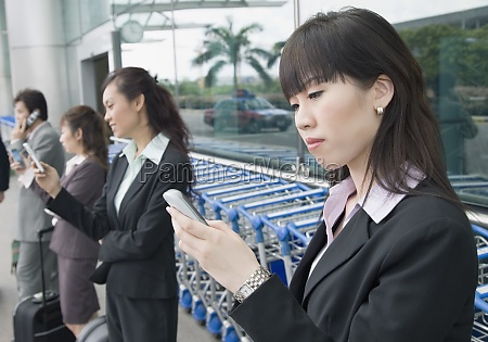 three businesswomen with a businessman waiting
