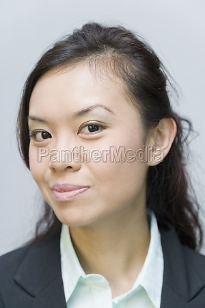 portrait of a businesswoman smirking