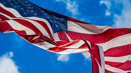 american flag blowing in wind against