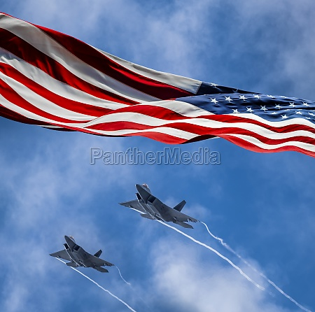 american flag blowing in wind and