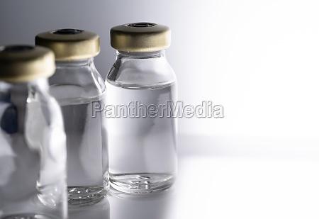 studio shot of laboratory vials with