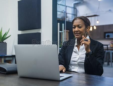 businesswoman working on laptop at desk
