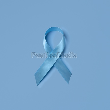 studio shot of blue ribbon symbolizing