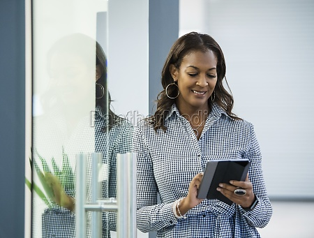 smiling businesswoman using digital tablet in