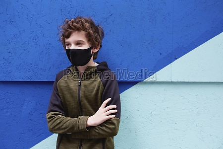 boy 8 9 wearing protective face