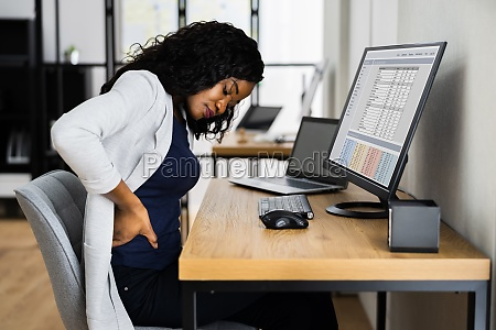 african woman with back pain
