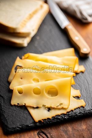 sliced smoked hard cheese
