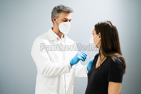 pregnant woman vaccine injection by doctor