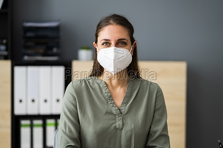 receptionist woman wearing medical mask