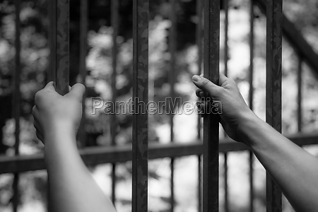 prison cell close up of hands