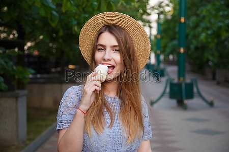pretty girl in summer hat with
