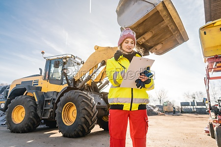 woman with clipboard in front of