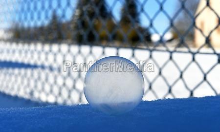frozen soap bubble in front of